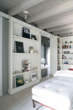 sliding bookcase - for door into ensuite bathroom