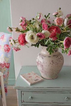 distressed vase with pink and white flowers on turquoise dresser - the colors compliment each other