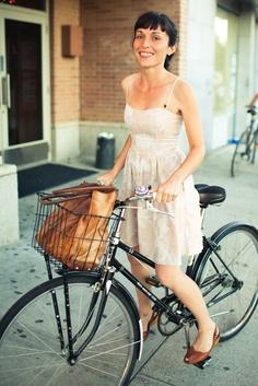 her cutest dress, bangs, and bag in her super cool bike basket and bike. she just looks so cool.