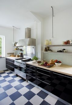 love the checkered floor and butcher block counters.