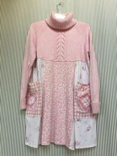 Upcycled Soft Pastel Pink Patchwork Sweater Dress Sweater is a Blend of Cotton, Nylon, and Angora . Vintage Cotton Jersey Knits with little pink roses 2 Front Pink Gingham Pockets Sweater is labeled a size large Measured laying flat- 19 1/2 inches across bust area 33 long 27 across
