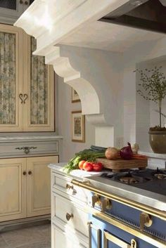 love the korbels and white shelf...love the cabinets with the lovely fabric curtains
