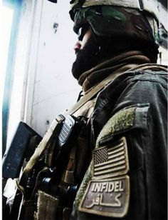 """U.S. SOF wearing an """"Infidel"""" patch, in both Arabic and English. There are several USA-based companies doing a brisk business selling these kinds of patches, mostly under the """"trouble makers"""" section. Bush Jr, Trouble Makers, Colorado College, Armed Conflict, Military News, Pop Culture References, Confederate Flag, Islamic World, Armies"""