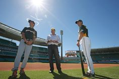 Australian Baseball player Craig Anderson, left, and coaches Jon Deeble and Glenn Williams, right, inspect the baseball field especially built for the Major League Baseball opening series at the Sydney Cricket Ground in Sydney, Monday, March 17, 2014. The MLB season-opening two-game series between the Los Angeles Dodgers and Arizona Diamondbacks in Sydney will be played this weekend. (AP Photo/Rick Rycroft)
