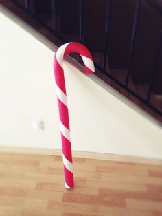 Giant candy canes I made out of red pool noodles, white duck tape and wire hangers. Bend the hangers after you put them inside the noodle.