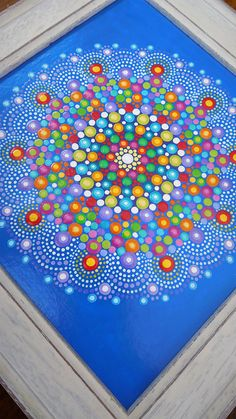 This kaleidoscope mandala is an original painting on acid-free board and framed in an off- white wooden distressed profile frame. This is a bespoke item created with love and a lot of time and concentration. I painted this mandala in dots of acrylic paint it is a very tactile and