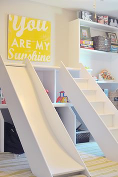 I love the idea of a slide somewhere in the house for the kids to play on during rainy days.