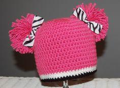 Bright Pink Pom Pom Hat with Zebra Ribbon.