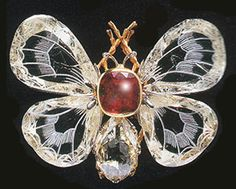 Boucheron diamond and ruby butterfly brooch.  The wings are made of engraved diamonds.