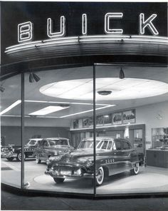this vintage car dealership and auto shop can be compared to mr wilson 39 s car dealership old. Black Bedroom Furniture Sets. Home Design Ideas