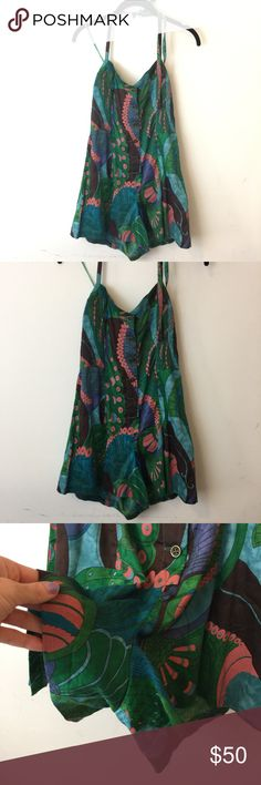 Free People Green Peacock Printed Halter Romper Free People Romper with a halter top and a soft cotton body- peacock printed and is a size 8! Free People Pants Jumpsuits & Rompers