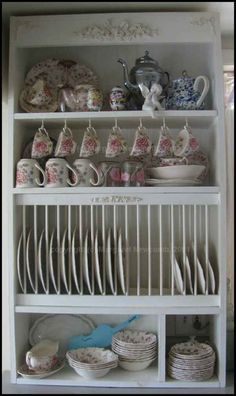 DIY plate rack cabinet. Minus the fancy details.