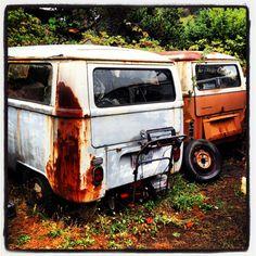Rusty VW baywindow bus.