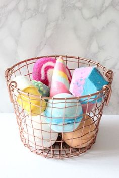 i like the idea of having a basket to display pretty bath-bombs in, as long as they wouldn't get weird from shower steam.