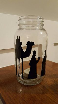 Bring the true meaning of Christmas to your home with this vinyl adhesive nativity scene. You are purchasing the vinyl ONLY ~ mason jars NOT included! The nativity scene includes all cut out pieces seen in the picture - camel, 3 wise men, manger with holy family, 2 sheep and 2 shepherds. The pieces are scaled to fit quart-size mason jars, but can be adjusted to fit any size glass containers (mention when purchasing in the comments section the dimensions you would like if different from…