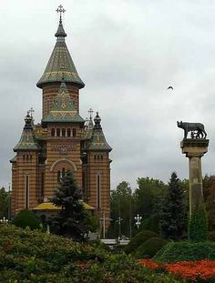 Orthodox Metropolitan Catedral of Timişoara, with the statue of Capitoline She-Wolf and twins Romulus and Remus - photo Religious Architecture, Architecture Design, Romania Travel, Romania Tours, Wonderful Places, Beautiful Places, Romulus And Remus, Beautiful Wolves, Old Churches