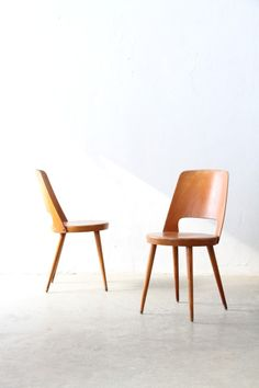 Theo Baumann; Wood and Bent Plywood Chairs, 1950s.