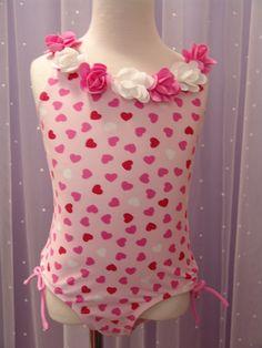 Kate Mack heart swim suit available at LuLu Belle Children;s Boutique.