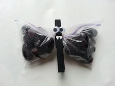 "Grape ""Bats"". Made these for daughters Pre-School class. Great non-candy Halloween alternative. Black grapes, snack size zip-lock bags, clothes pins, googly eyes."