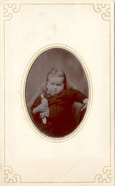 Tiny one with tiny doll tintype