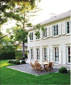 Spacious Family Backyard A series of French doors open out to the yard. A pea-gravel terrace designed by Ron Holbrook is a charming addition to the backyard of the 2011 Princess Margaret Showhome Perfect Patio, House Exterior, Show Home, Stucco Colors, Exterior Paint, Family Backyard, White Shutters, Beautiful Homes, Exterior