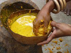 Ikat textile weaving creating natural yellow dye from tumeric.
