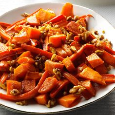 Roasted Squash, Carrots & Walnuts Recipe -After the turkey's done, I dial up the oven temp and roast carrots and squash for this yummy side. That frees me up to start the gravy. —Lily Julow, Lawrenceville, Georgia