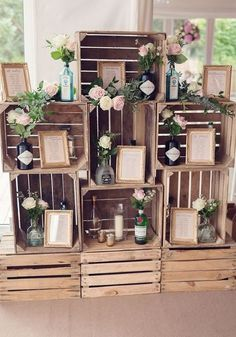 It would be super easy to DIY this rustic stacked wooden crates table plan, featuring seating plans displayed in photo frames and jars and bottles of flowers! This Pink And Gold Wedding Is Too Pretty To Miss - so check it out and be inspired on Wedding Id Wooden Crates Table, Wooden Crates Wedding, Rustic Wooden Box, Pallet Wedding, Wooden Wedding Decorations, Wooden Crates Stacked, Diy Engagement Decorations, Tree Centrepiece Wedding, Vintage Table Decorations