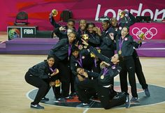 Members of the U.S. women's basketball team pose with their gold medals during victory ceremony at the North Greenwich Arena.