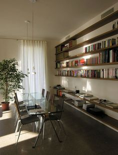 """HONE"" bookcase with shelves in National walnut, support in iron , realized on measure for this wall / - Lauro Ghedini Design"