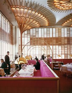 "Warren Platner designed the American Restaurant in Kansas City in 1974 as part of a complex of modern buildings commissioned by the Hall family of Hallmark Cards. He described the bentwood, brass and lipstick-red interior as ""like a huge lace Valentine."""