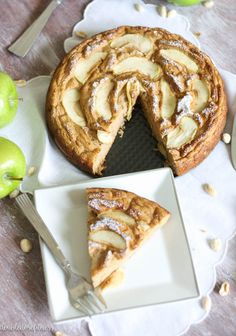 Peanut Butter Apple Snack Cake - A decadent and rich peanut butter cake filled and topped with juicy, sweet spiced apples. This recipe combines some of the best ingredients into one super soft, moist cake that's filled with incredible fall flavors and wonderful textures with each bite. Drizzle the cake with a warm caramel sauce that will leave you wanting more! | A Double Dose