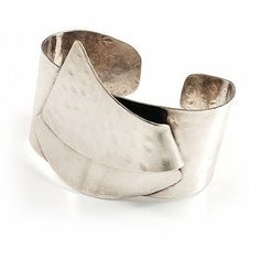 Hammered Stainless Steel Tribal Sail Cuff-Bangle Avalaya. $90.00. Style: tribal. Occasion: casual wear. Type: handmade, hammered. Collection: creative dezigns. Metal Finish: stainless steel