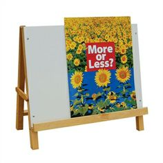 "Tabletop Big Book Easel - Handy hardwood easel is an essential for any classroom library! Features an 18"" x 24"" whiteboard with a 1"" deep ledge that holds the pages of big books open. A pocket behind the board stores the books. Measures 21½"" high x 24"" wide x 13"" deep and folds for storage."