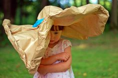 Mini-fashionista with a paper sunhat.