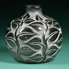 20TH CENTURY DESIGN - SALE 2603B - LOT 200A - , RENE LALIQUE SOPHORA VASE, ART GLASS, NARROW FLARED RIM ON BULBOUS VASE DECORATED WITH LEAVES ON SMOKY GRAY GLASS, MARKED R. LALIQUE - Skinner Inc