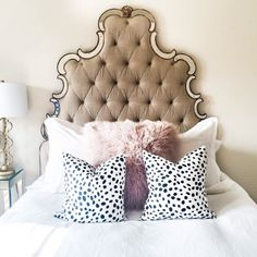 tufted linen headboard edged with antique mirrors