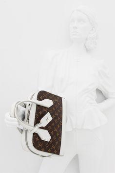 As seen on Louis Vuitton's Spring Summer 2015 runway: the Dora Monogram PM handbag at the Louis Vuitton Series 2 Exhibition #LVSeries2