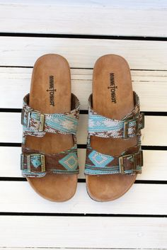 Slip into stylish comfort with the Gyspy Sandal from Minnetonka. These slide-on summer shoes feature two adjustable straps with buckle details and cushioned footbeds, resulting in summer's version of Western Shoes, Western Chic, Western Wear, Cowgirl Style, Cowgirl Boots, Cute Shoes, Me Too Shoes, Shoe Boots, Shoes Sandals
