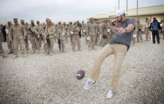 NFL Stars Jimmy Graham, Pierre Garcon and Brandon Fields visit troops in the Middle East on USO tour in 2014.