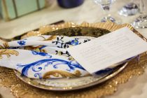 Gold Charger plate with beautiful satin napkin. Wedding Pavilion at the ETI – International Tourism Expo 2016