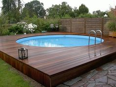 modern above ground pool decks ideas wooden deck round pool lawn stone slabs