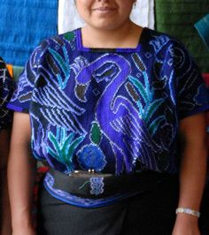 Flamingo Huipil Mexico    Here's a photo from Zinacantan, a Maya town in the highlands of Chiapas, of a woman wearing a hand embroidered huipil with a large blue flamingo on it