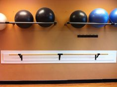 This is basically how I store my exercise balls, but I need even more space