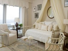 Soft restful colors, love the daybed and chairs, rug, lucite table, etc.