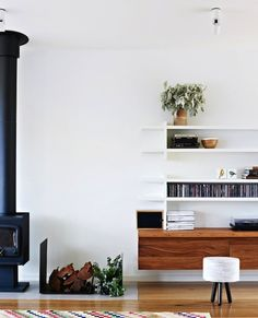 Minimal Living Room With Black Fireplace
