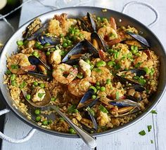 Seafood paella: This impressive Spanish one pot, with monkfish, king prawns and mussels, is perfect for feeding a crowd at a dinner party