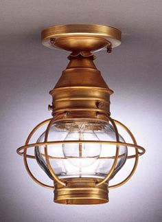 Northeast Lantern Onion Caged Flush Outdoor Close to Ceiling Light A customer favorite, our Onion Collection is carefully cut, soldered, finished and - Verdi gris finish, seeded clear glass. from lighting universe. Cage Light Fixture, Light Fixtures, Copper Lighting, Flush Mount Lighting, Copper House, Lighting Universe, Copper Lantern, Glass Globe, Lowes Home Improvements