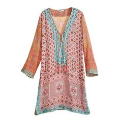 df897f40443 Embody the Calypso spirit with this stunning printed cotton gauze tunic.