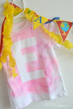 Kid friendly DIY project. Let them make their own t-shirt with their initial on the front. An inexpensive and easy project using a freezer paper stencil and stray fabric paint.